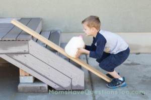 Using-a-ramp-to-lift-milk-onto-porch-Moms-Have-Questions-Too-499x332